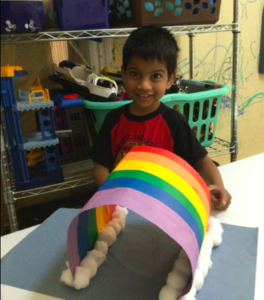 Boy with 3D paper and cotton ball rainbow