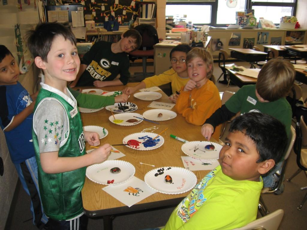 students paint at their desks