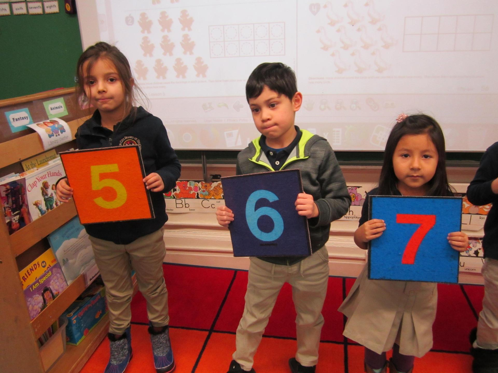 boys and girls holding number 5-7