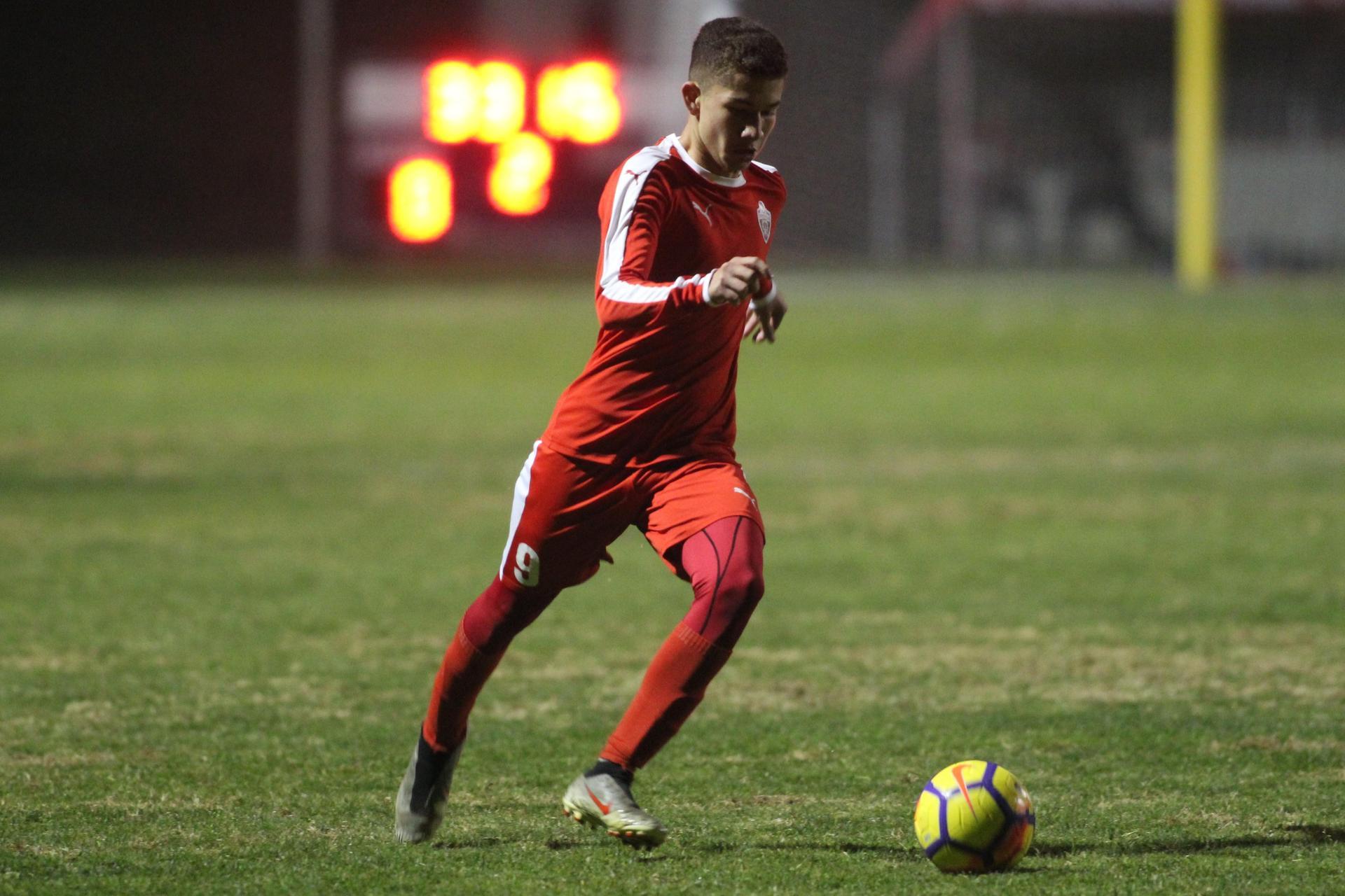 Student kicks the ball