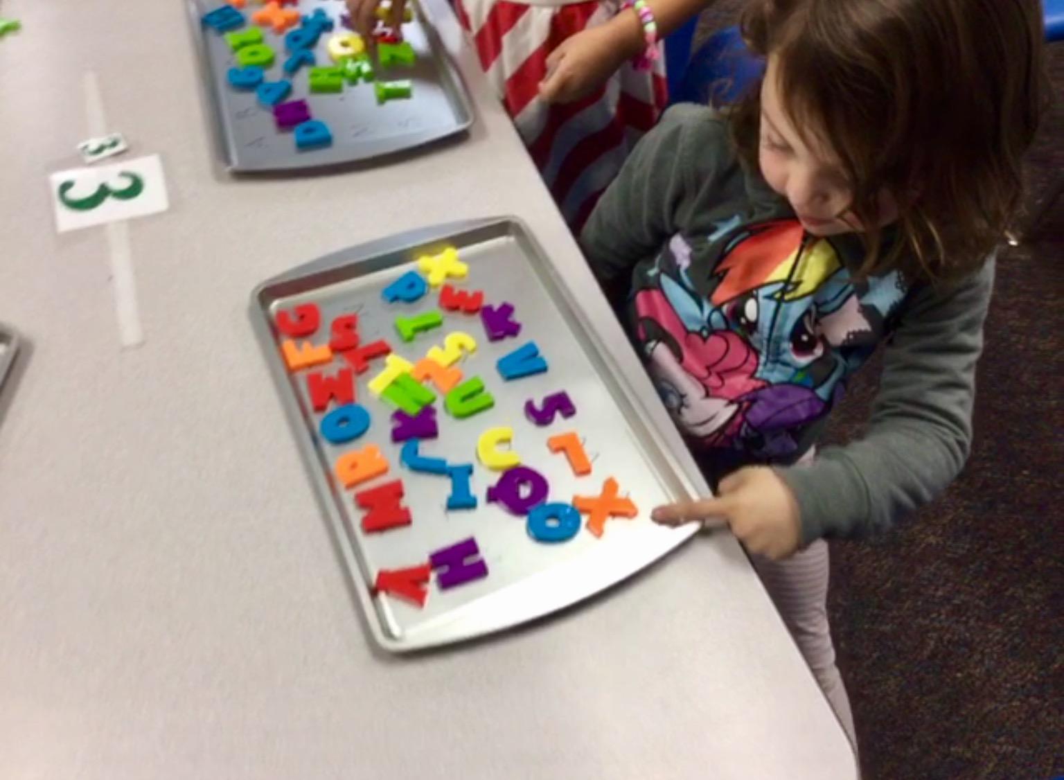 preschool students working on letter ID