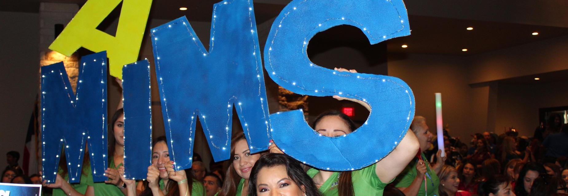 big blue letters with lights spelling Mims