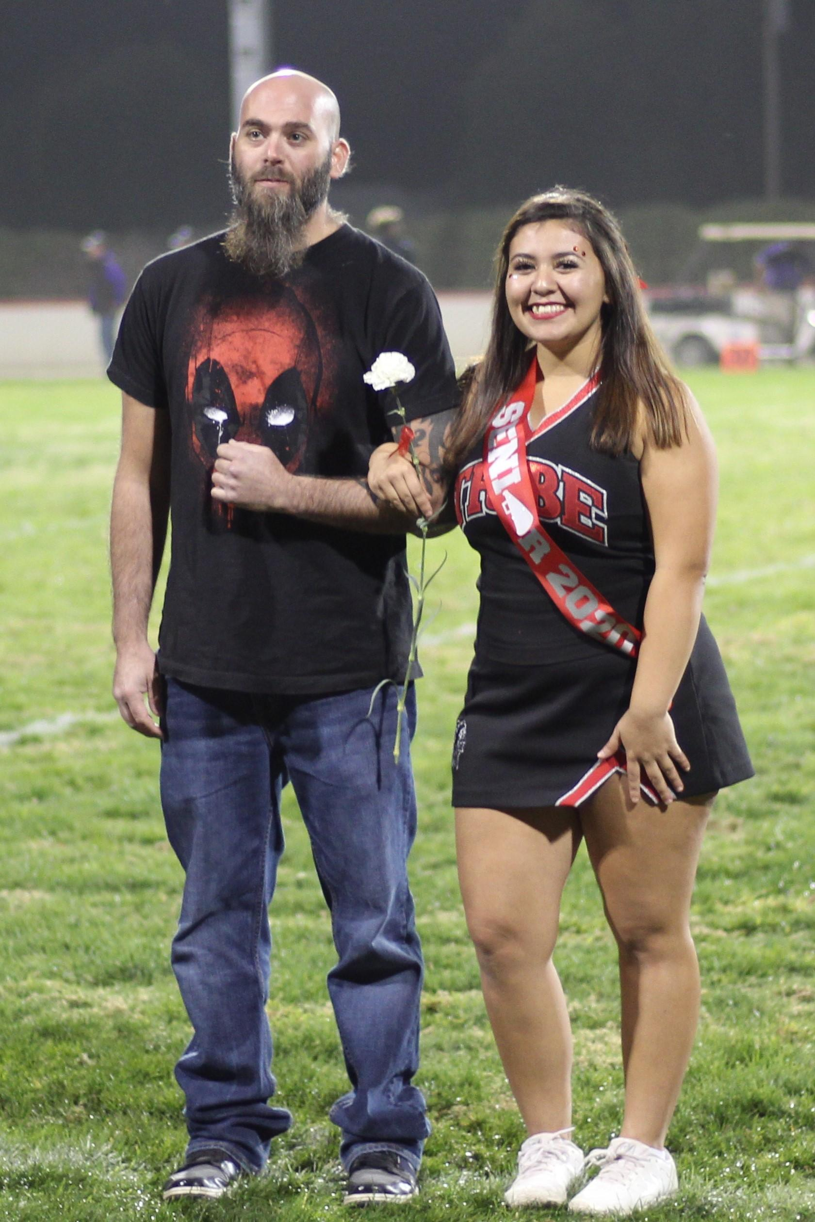 Senior cheerleader Kayln Hobart and her escort.