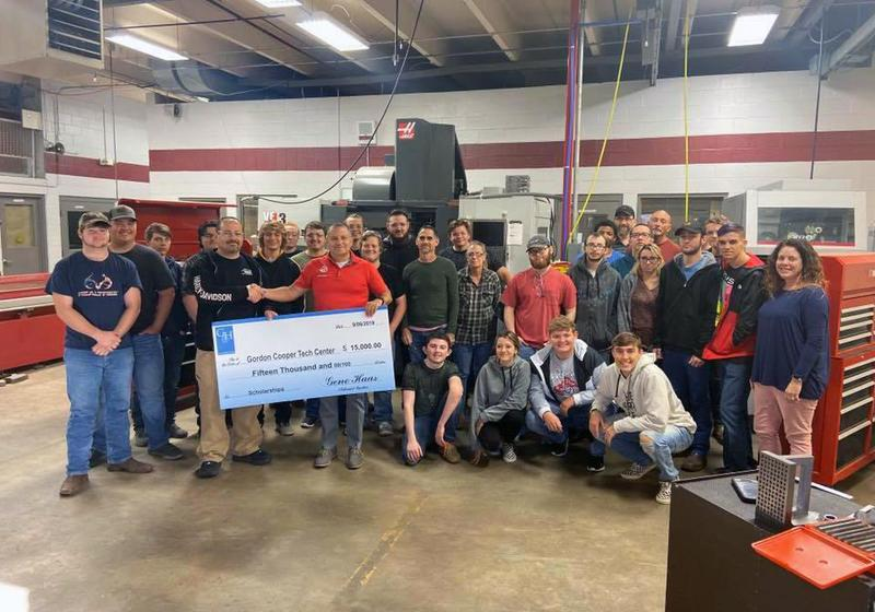 Reps from the Gene Haas Foundation presented a check to GCTC staff and students Thursday.