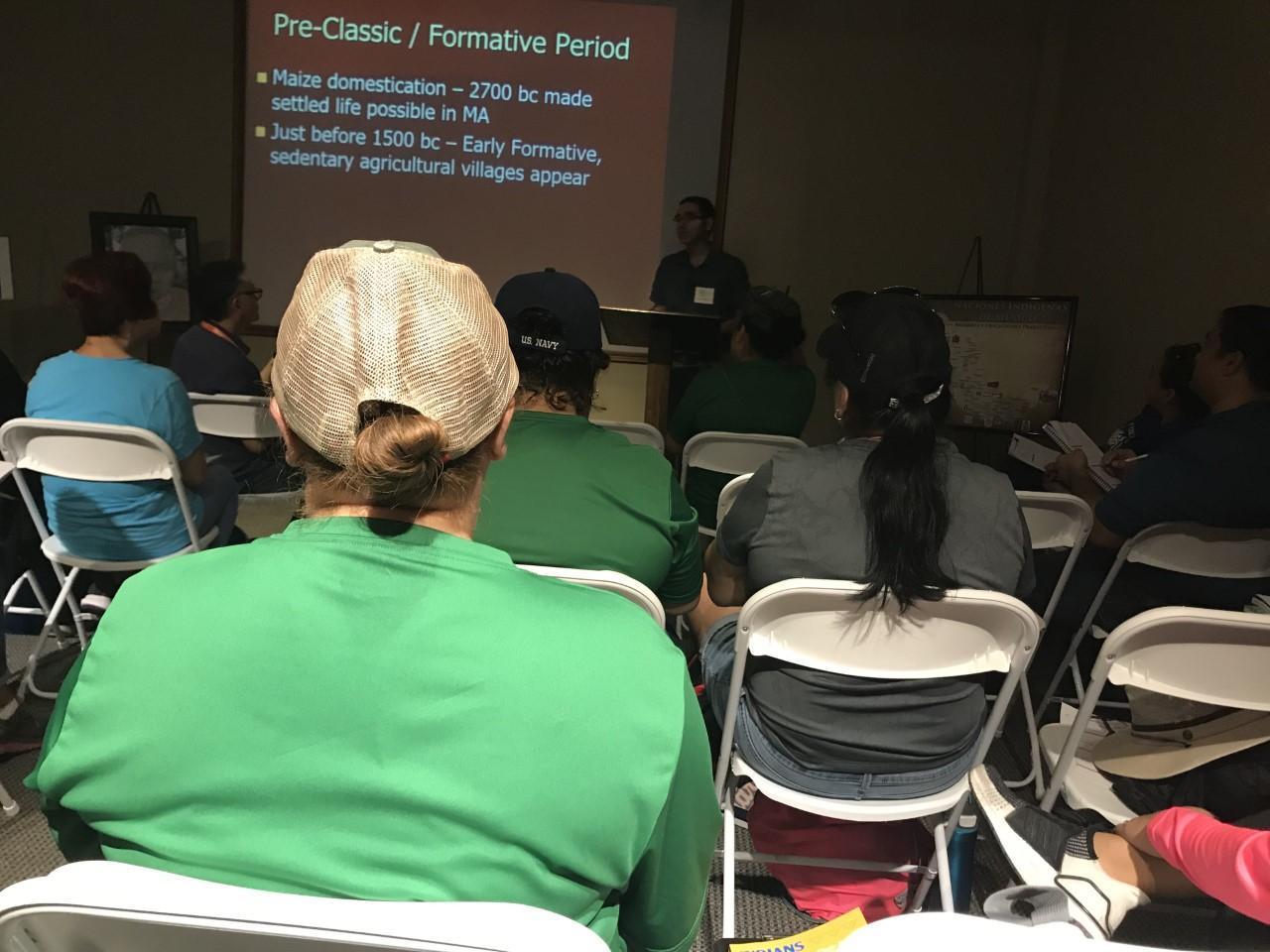 teachers looking at a presentation