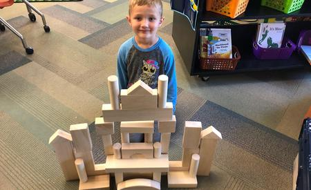Kindergartner building his version of a castle