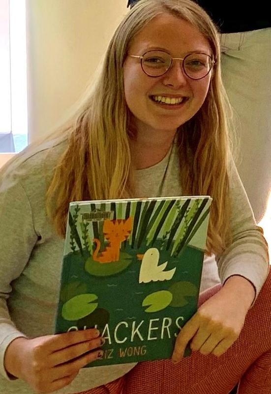 teen holding book