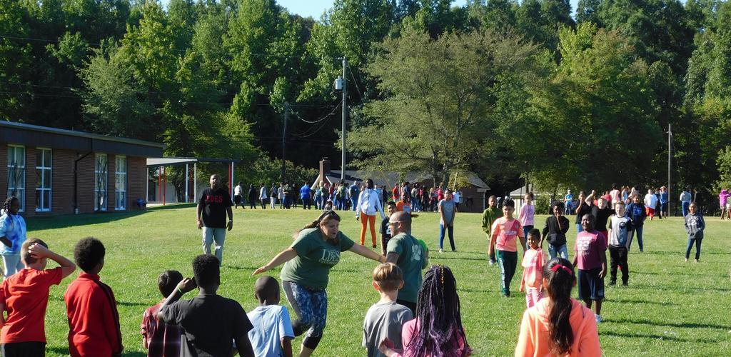 Teachers and students playing kickball