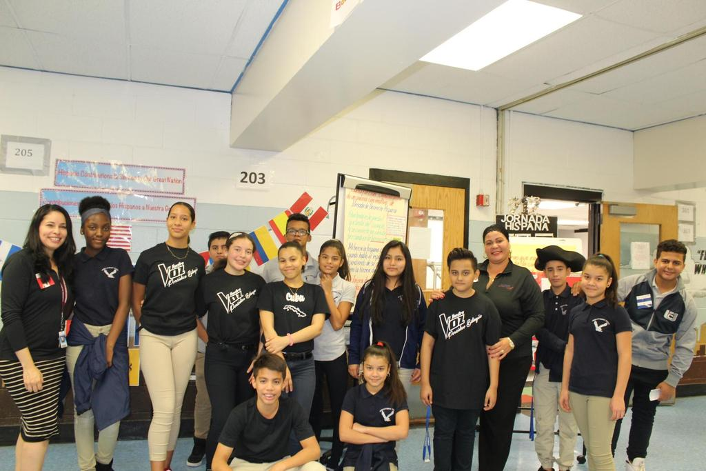 Mrs. Fernandez and her class with an aide