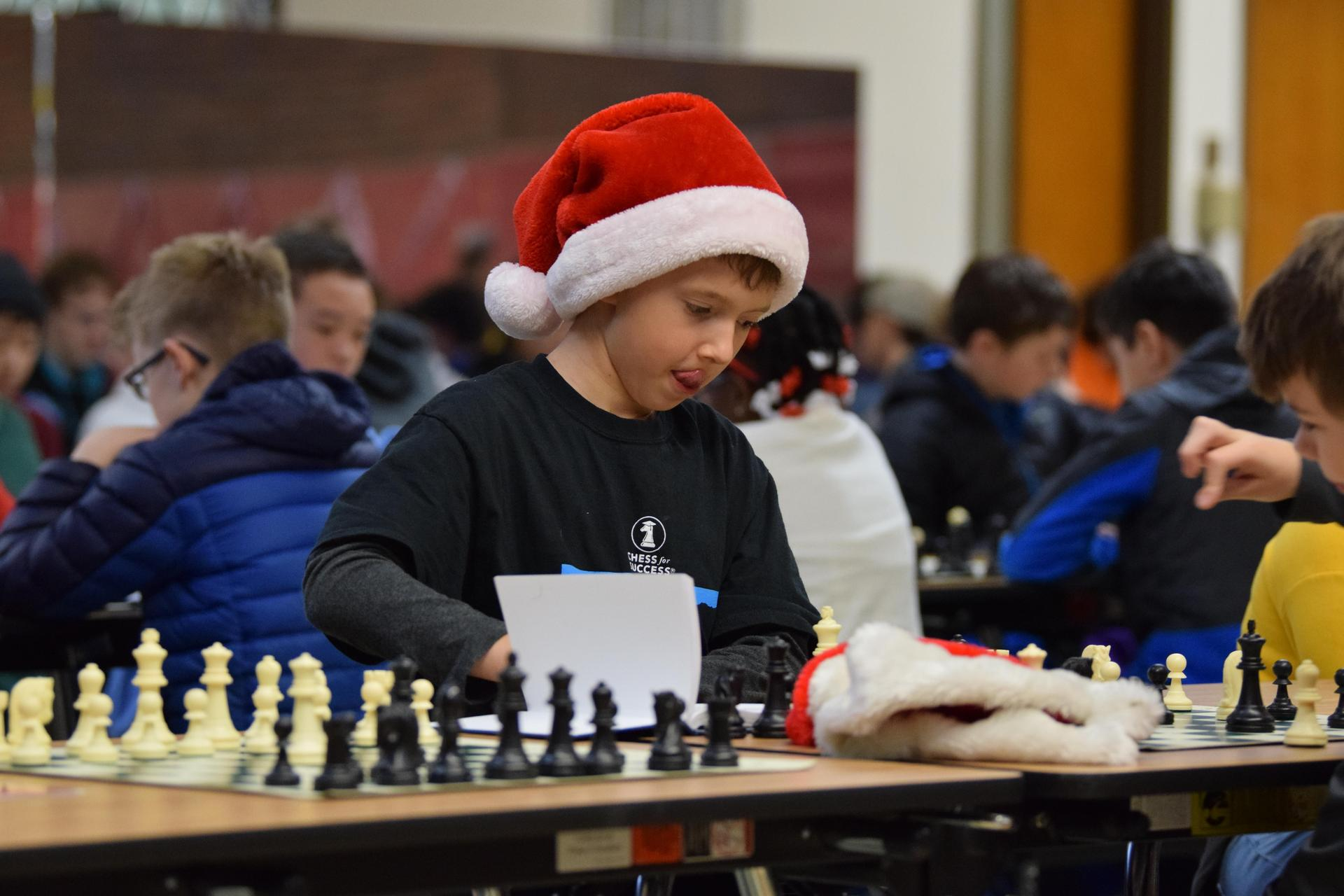 young boy playing chess