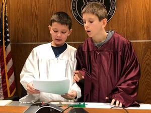 two boys dressed as judges