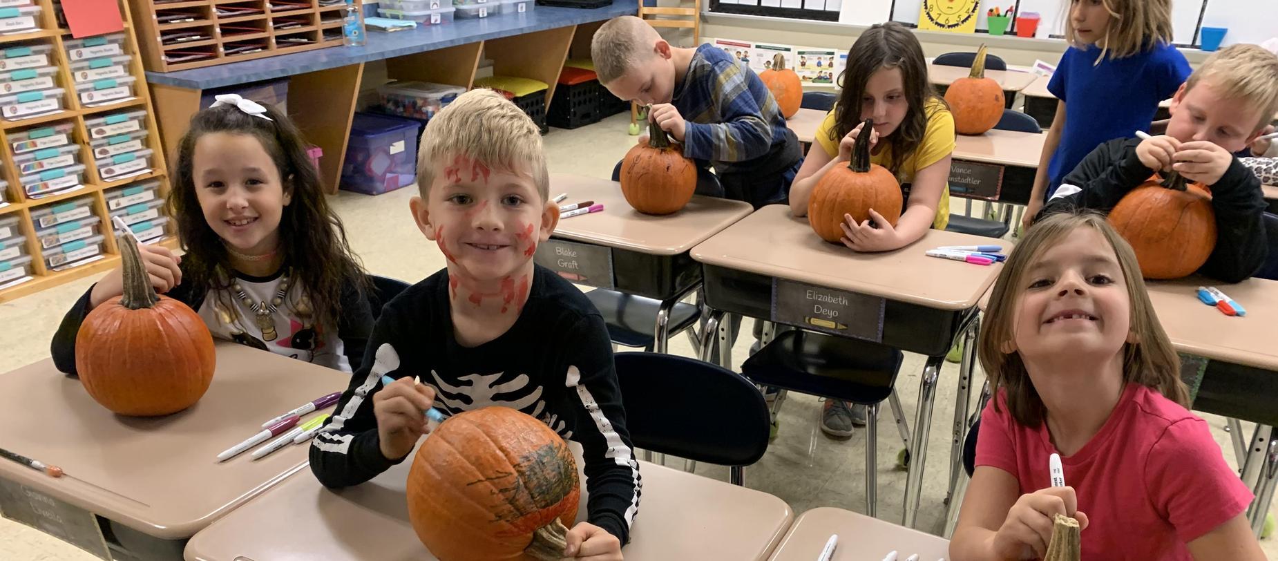 kids coloring pumpkins