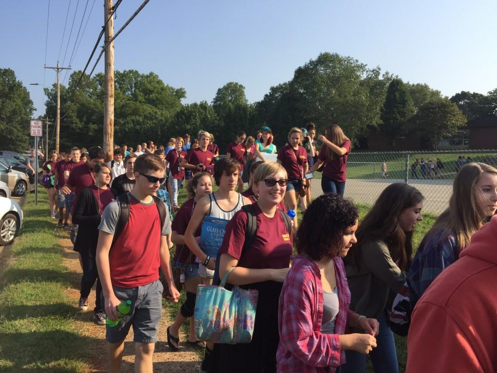 Students board bus for annual field trip