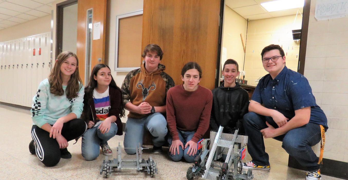 Members of the TKHS Robotics team prepare for competition.