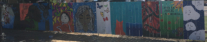 mural at downtown manor picket fence