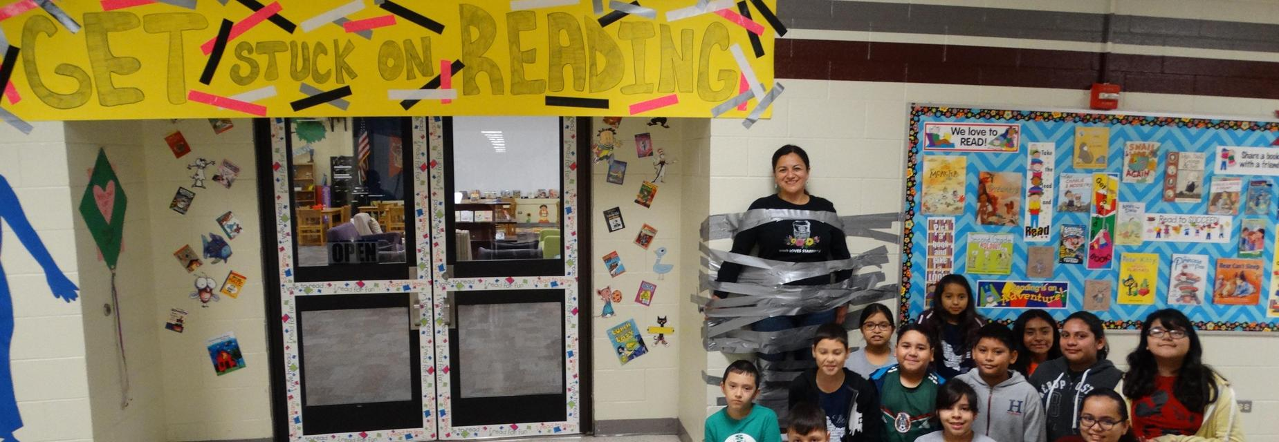 3rd grade teacher taped to the wall