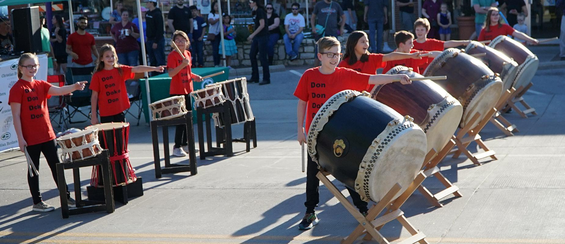Elementary school students playing drums
