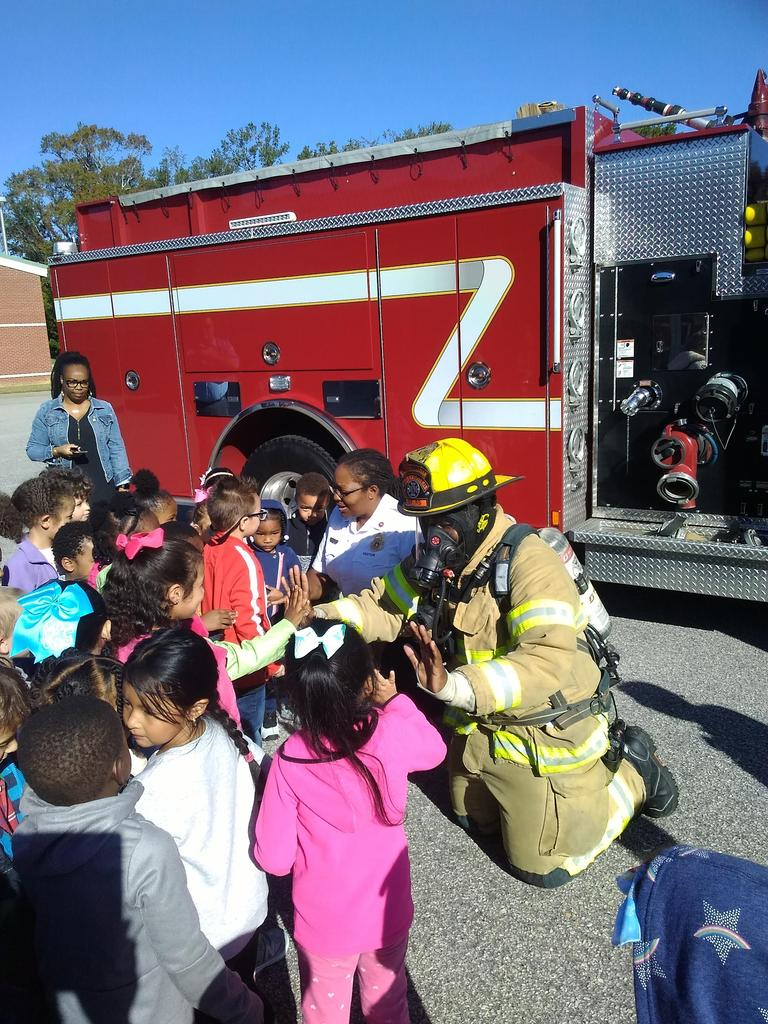 Students get to touch a firefighter who is in full gear.