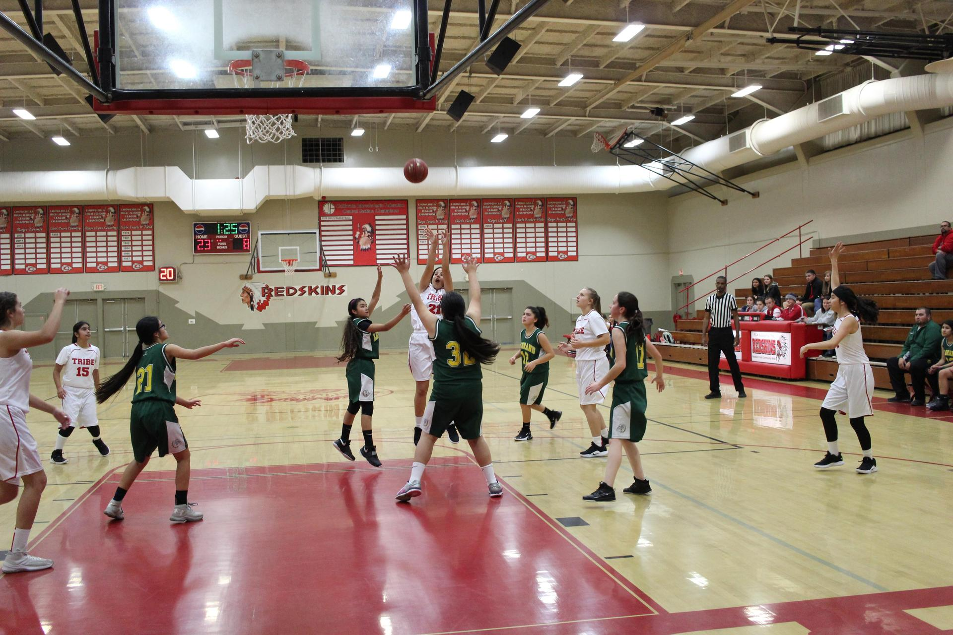 Junior varsity girls playing basketball against Le Grand