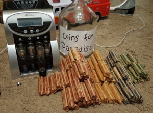 rolls of coins and a coin counting machine