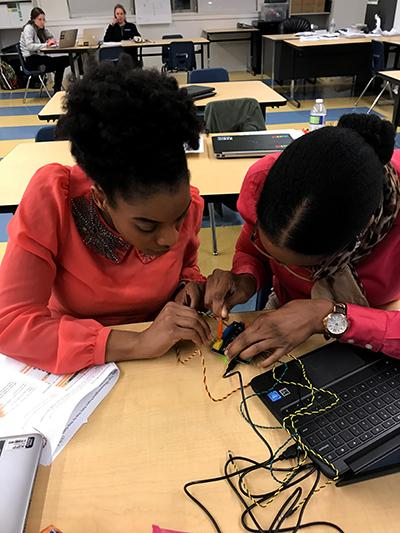 Students work on their coding projects on laptops