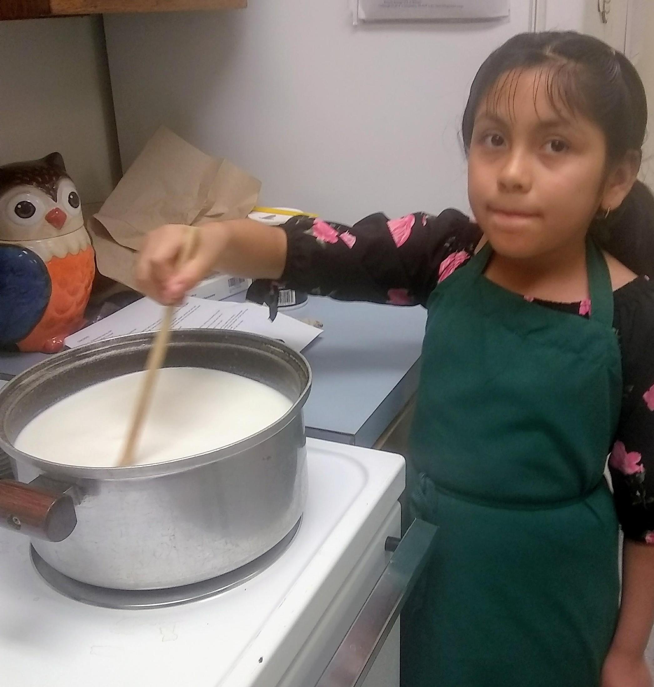students making cheese from milk and vinegar