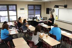 Teachers listen as Mrs. Larios trains them in ASB procedures the day before school starts.