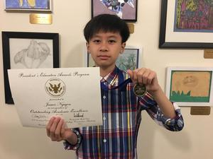 A picture of a 7th grade male receiving his Global Learner Award.