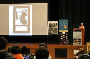Photo of:  Holocaust survivor Judy Reifer speaks to Edison 8th graders on March 1 about her earliest years hidden by a priest with other Jewish children in a church basement until the end of World War II in 1945.