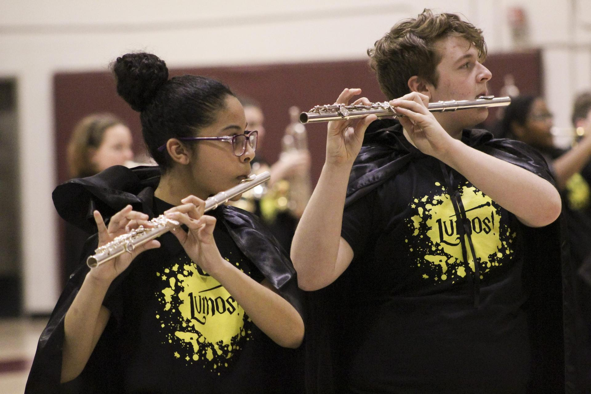 SoundSport flutists playing concert in high school gym