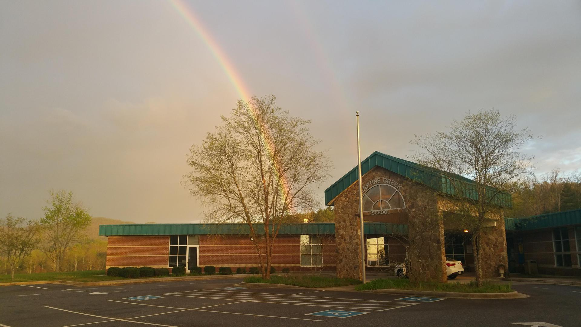 Martins Creek School, front view with rainbow in sky