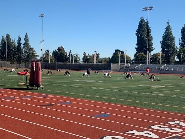 Arcadia High Boys Football team physically distanced while conditioning