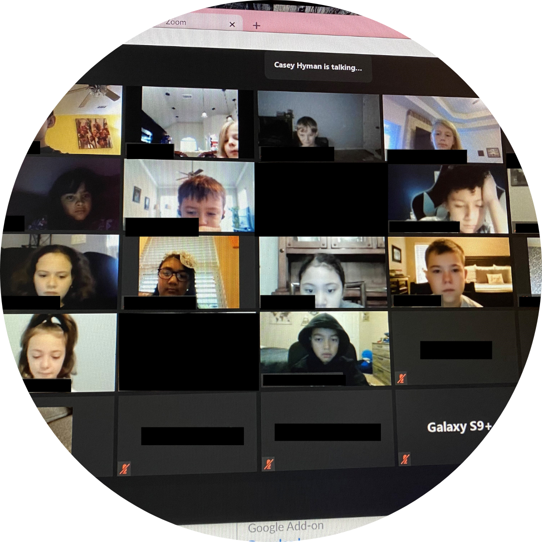 computer screen with many faces in digital meeting
