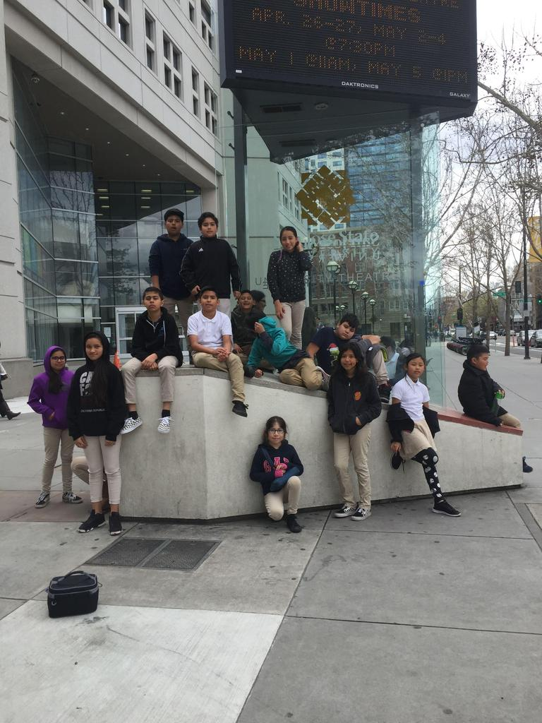 students pose for a picture in downtown San Jose