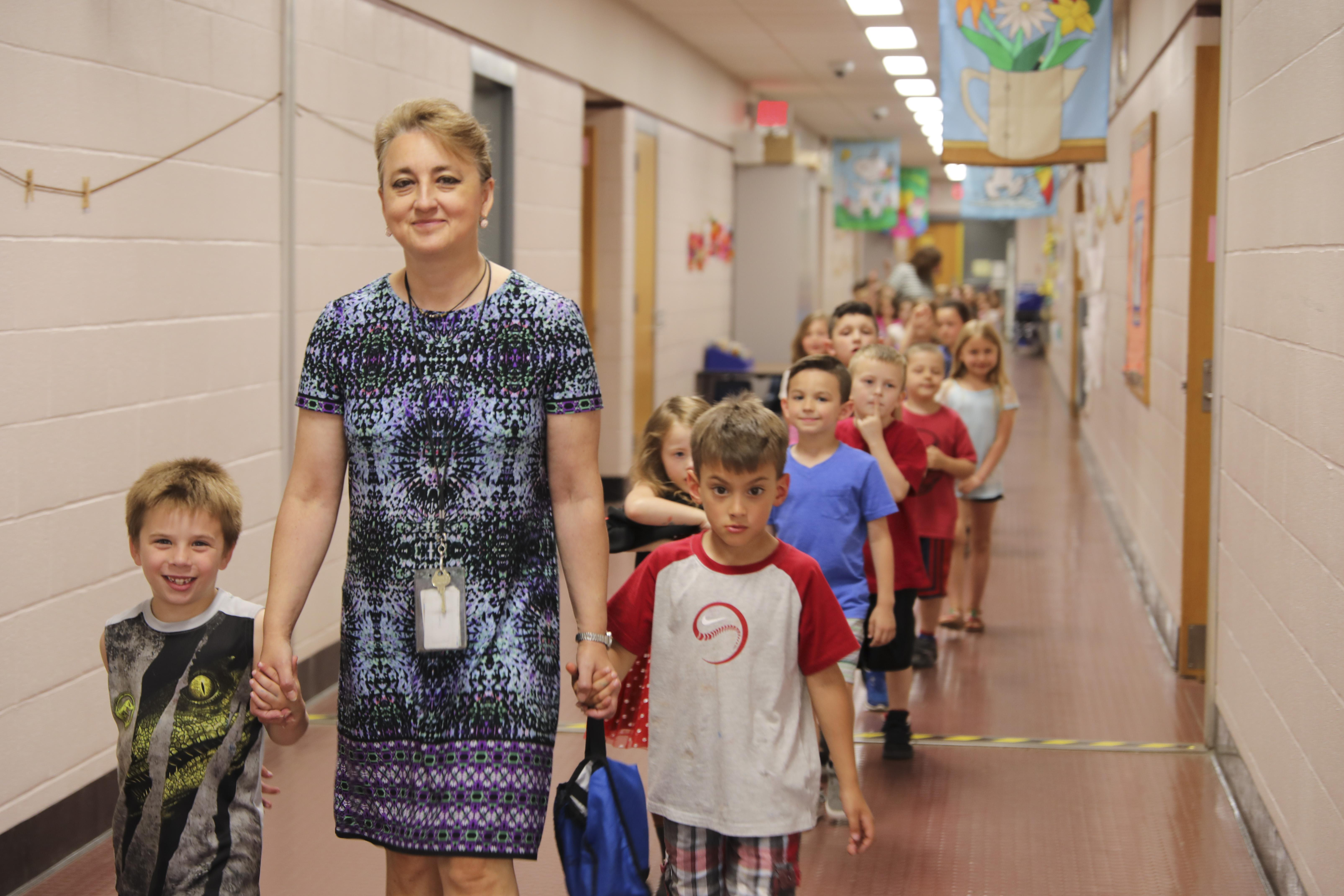 Teacher walking with class down the hall