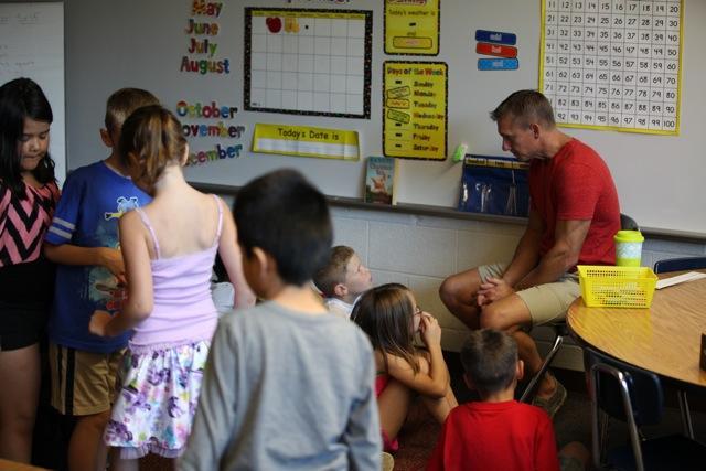 kids listening to teacher