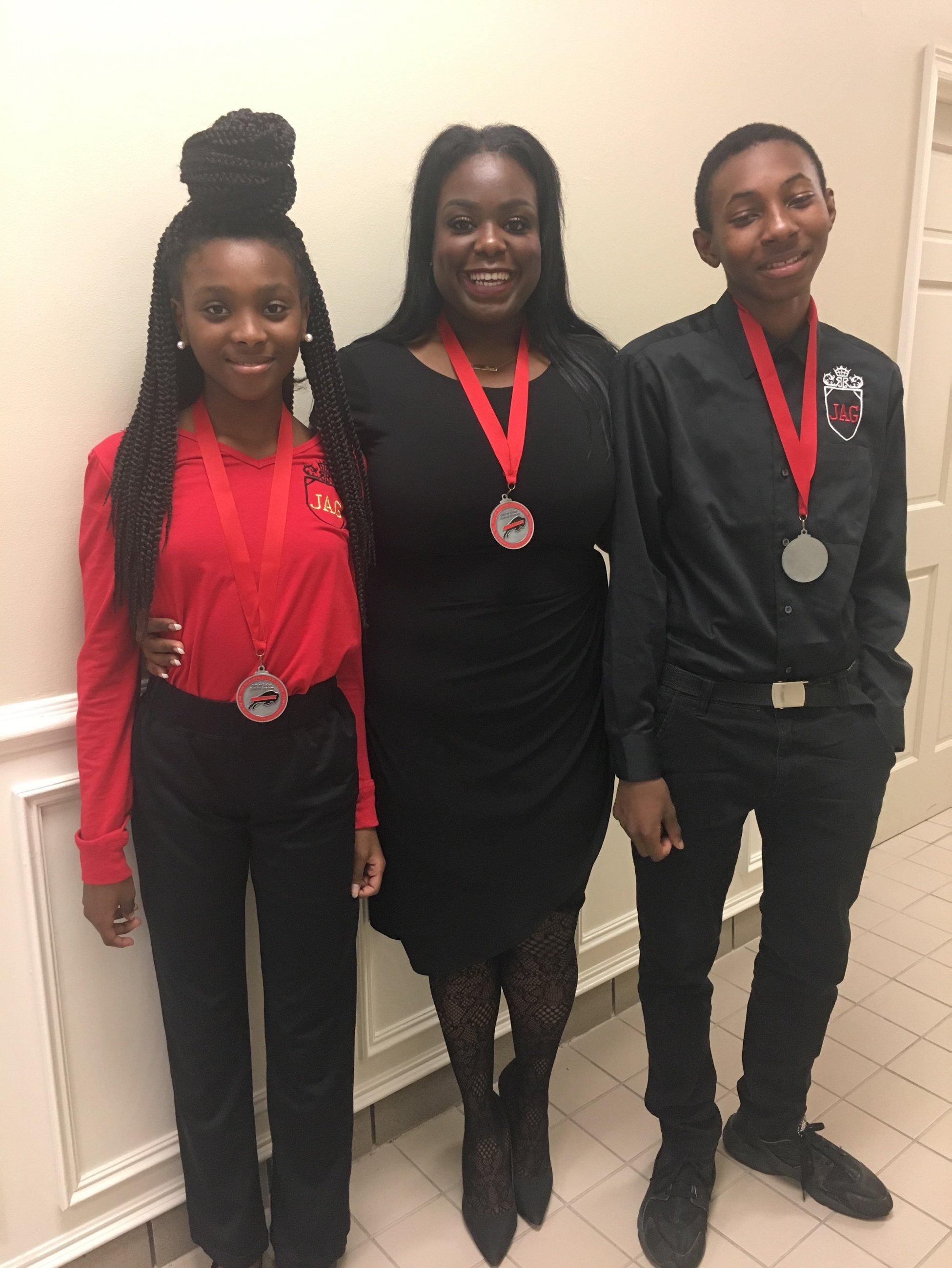 A photo of Baker Middle JAG students and teacher awarded district medallions