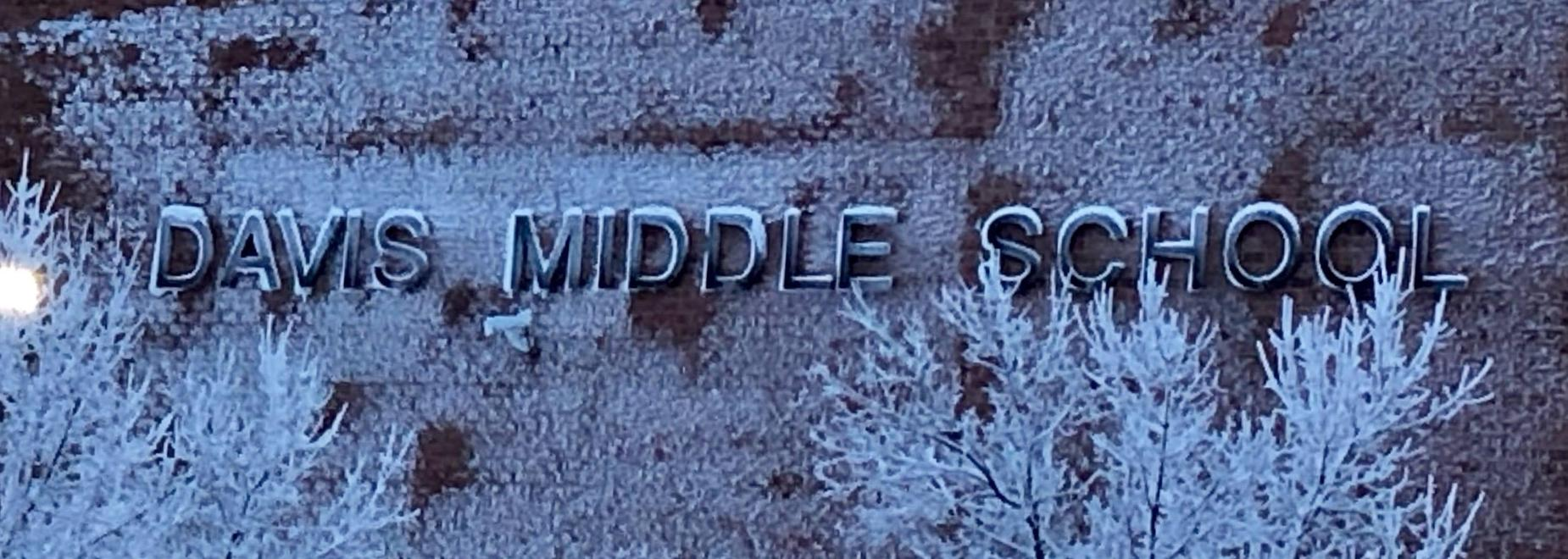 Davis Middle School outdoor sign covered in snow