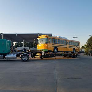 new electric bus being unloaded at EUSD transportation yard- 1