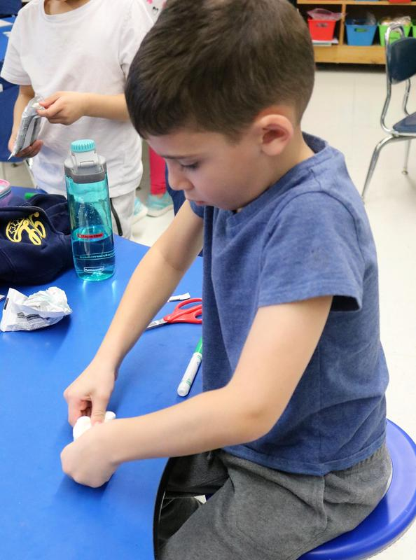 A student in Ms. Utman's afterschool STEAM club at Tamaques creates a