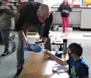 Mr. Sleeman pours samples of Faygo pop.