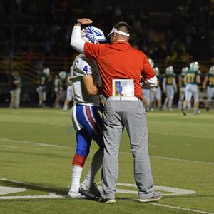 coach congratulates a player
