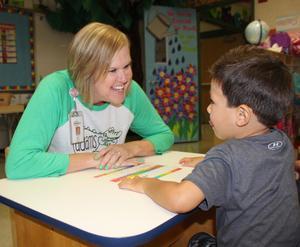 Principal visiting with new student