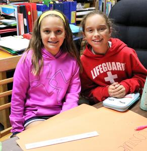 Photo of student members of Jefferson School Early Act Club working on posters for a Halloween Costume Drive.