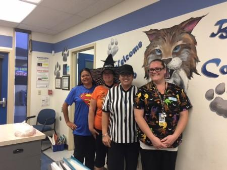 Office staff with Principal in costume