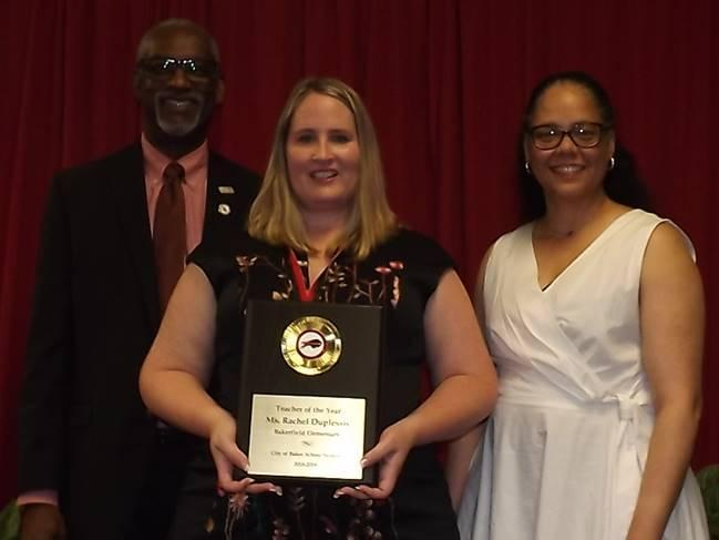 Photo of Superintendent Brister & Board President Boxie with employee of the 2018-19 year