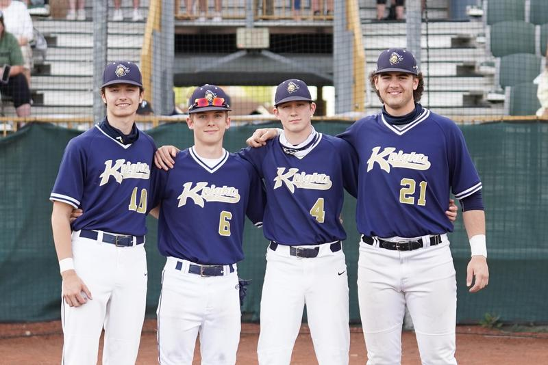 pic of 4 baseball players on the field