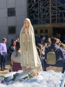 Statue of Mary carried through Christ the King parish community for Marian Procession on October 7.