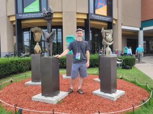 Jeff Bohl standing in front of his sculpture display