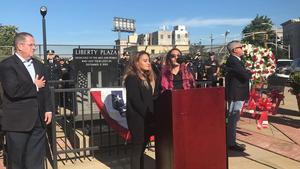 2 girls singing at podium outside